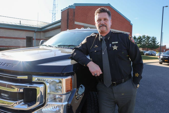 Portage County Sheriff Bruce Zuchowski stands next to the Ford F-250 truck purchased by the county. Portage County Commissioners recently approved union contracts covering 173 unionized staff members in Zuchowski's department.