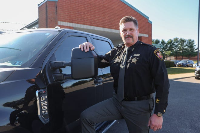 Portage County Sheriff Bruce Zuchowski stands next to the Ford F-250 truck purchased by the county.