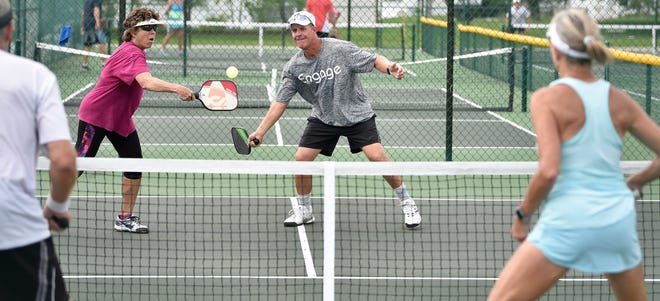 In a June 2018 contest at Sarasota's at Sun N Fun RV Resort, Carrie Palmer hits with teammate Scott Tingley against Scott and Michelle Foster. Pickleball courts were among the top active amenities Venice residents would like to see in a new Northeast Venice park.