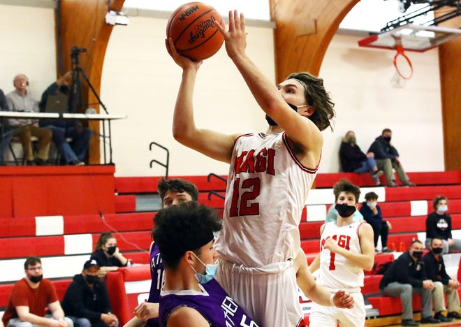 Josh West rises up to score two points for Colon against Athens on Thursday.