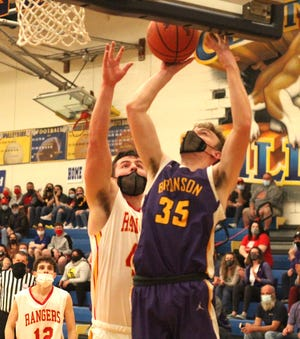 Noah Houtz of Bronson rises up to score two points for Bronson against Reading on Thursday.