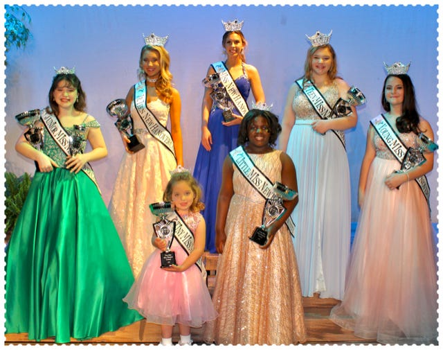 Scholarship pageant: Pictured from left to right:    Jr.  Miss Ila Monical,  Jr. Teen Sommer Bradley,                        Tiny Miss Anna Cate Coiro, Miss New Hanover County Cara Insco, Little Miss  Atiya Johnson (gold dress), Teen Miss  Emma Hansen and                             Young Miss Sadie Tew.