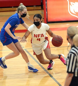 NFA's Jenissa Varela drives on Waterford's Izzi Fraser Thursday during NFA's 57-33 ECC South Tournament win in Norwich.