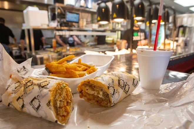 The Fat Shack sandwich is packed with cheesesteak, chicken fingers, jalapeño poppers, mozzarella sticks, French fries, onion rings and your choice of sauce all wrapped together. Get it with a side of fries and a shake, but remember to loosen your belt before devouring.