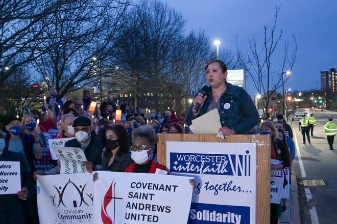Isabel Gonzalez-Webster, executive director of Worcester Interfaith, speaks at a candlelight vigil to support the striking nurses of St. Vincent Hospital on Thursday night.