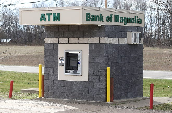 A man pointed a gun at an 81-year-old woman in a robbery attempt while she was in her car at this Bank of Magnolia ATM in Crossroads Plaza near Sandyville on Wednesday.