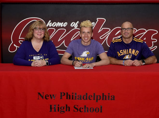 New Philadelphia senior Colin Roberts has committed to Ashland University to run track for the Eagles. Roberts is a standout for the Quakers in track and soccer. He is pictured with his parents, Chad and Christa Roberts.