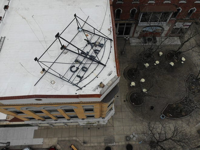 """This drone footage taken by the New Philadelphia Fire Department shows the """"Welcome to our City"""" sign laying on its side on top of the House of Stones building in downtown New Philadelphia Friday."""