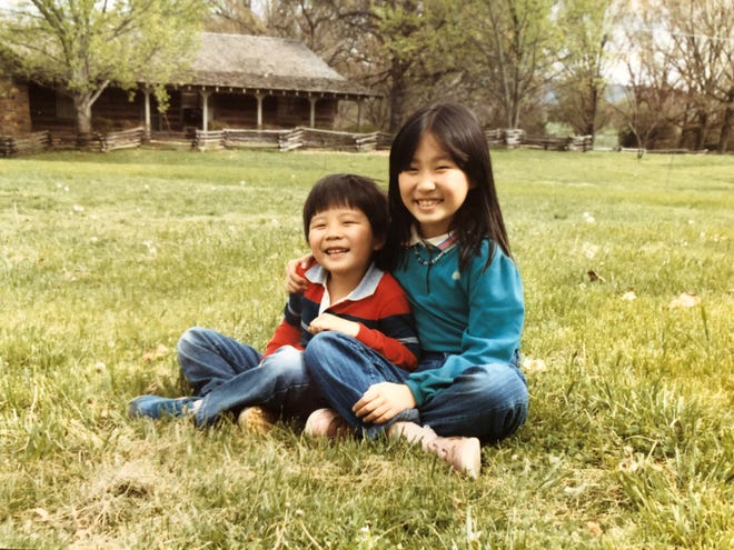 A photo of Isaac (left) and Leisle Chung (right) in Arkansas as children.