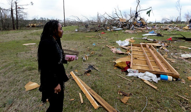 Brenda Pickens surveys the damage to family property on County Road 21 near Greensboro Friday, March 26, 2021. A Thursday tornado swept away a house and a mobile home from the hilltop near her. [Staff Photo/Gary Cosby Jr.]