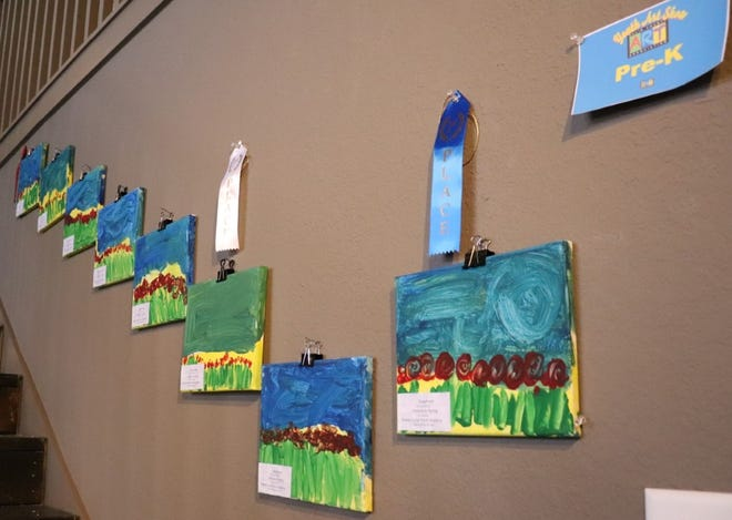 A wall is filled with artwork from pre-kindergarteners at Waxahachie ISD's Youth Art Exhibit recently. The district is holding a roundup for pre-K and kindergarten classes for this fall.