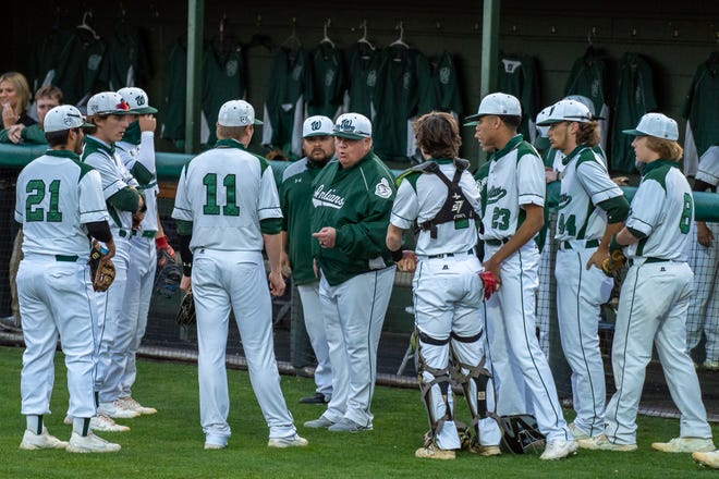 Waxahachie head baseball coach Tracy Wood speaks with his team between innings during last Friday's game against Duncanville at Richards Park. The Indians suffered a tough 8-5 home loss to Mansfield High on Tuesday night, allowing six runs in the seventh inning on only one hit.