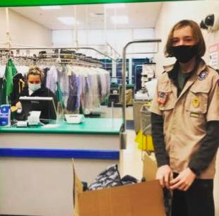 Scout Troop 132 drops off coats at Coats for Kids and Anton's Cleaners.