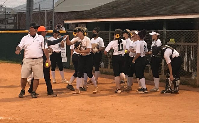 The Melbourne High softball team celebrates after a 1-0 victory over Cocoa on Thursday night.