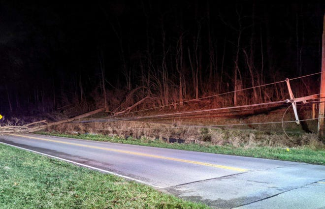 A power line is down along the Old 3C Highway at Foster-Maineville Road in Hamilton Township in Warren County on Friday morning