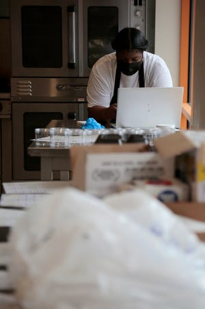 Candice Holloway, owner of Soul Secrets soul food restaurant opening in Over-the-Rhine, was the first to receive a grant from a new $100,000 grant program launched by The Cincinnati Chamber Foundation and Johnson Foundation.