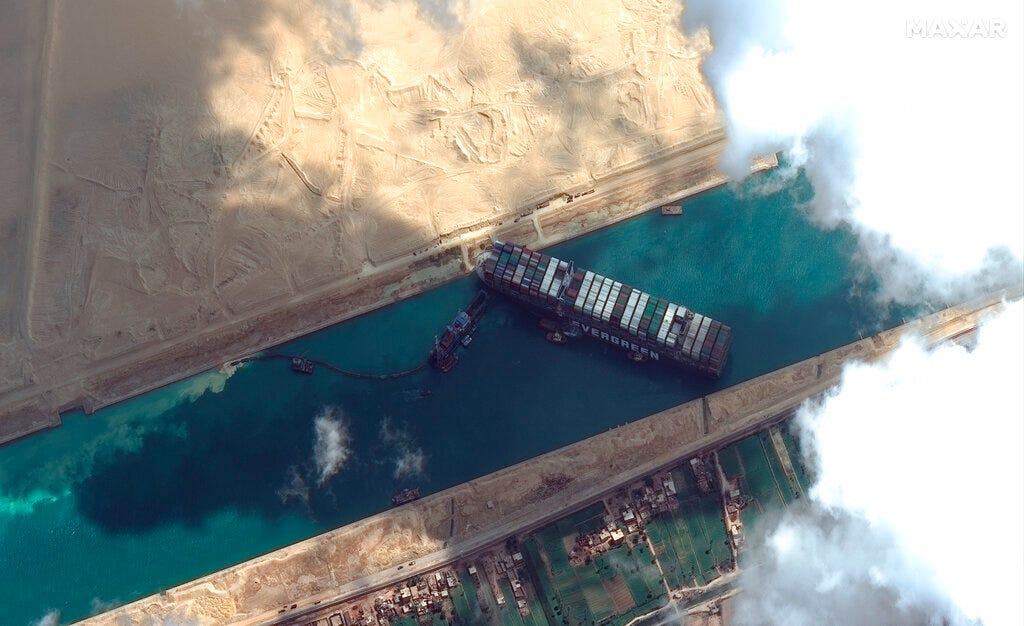 Plan made to refloat ship blocking Suez Canal using tide 1