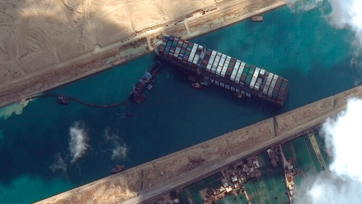 Plan made to refloat ship blocking Suez Canal using tide 2