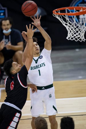 Northwest Missouri's Diego Bernard (1) shoots over Flagler's Jaizec Lottie (4) during the Division II men's basketballl semifinal on Thursday night in Evansville, Indiana.