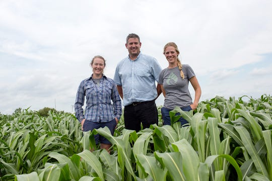 From left, Caitlin Moore, Carl Bernacchi, Katherine Meacham-Hensold and their colleagues review how rising temperatures affect photosynthesis in plants and how scientists are addressing the challenges.