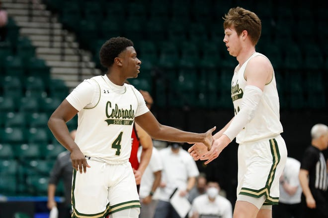 Colorado State basketball players Isaiah Stevens, left, and Adam Thistlewood high-five during the NIT basketball tournament on March 25, 2021.