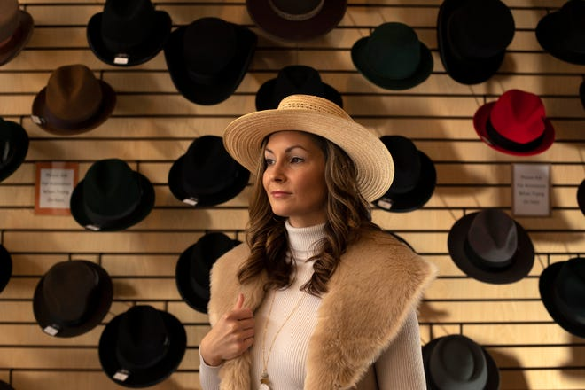 Brittany Berkovitz, owner of Hat-cetera, poses for a portrait at the Broadway District store. Berkovitz bought the business in 2019 and relocated the shop to 237 N. Broadway St.