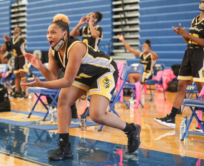 Central's Ca Mya Johnson cheers on her teammates during the game against Male at the Girls Seventh Regional semifinal at Valley High School. March 26,  2021
