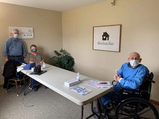 Bill and Suzy Wilson, left, visit Jim Rucker, right, in a visitation room at Kingston Residence of Marion. The Wilsons are now able to visit Rucker in his room due to COVID-19 guidelines relaxing.