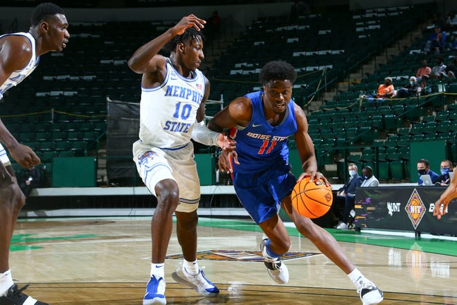 Thursday, March 25, 2021; Boise State's Devonaire Doutrive is guarded Memphis' Damion Baugh in the quarterfinal round of the NIT in Denton, Texas on Thursday, March 25, 2021.