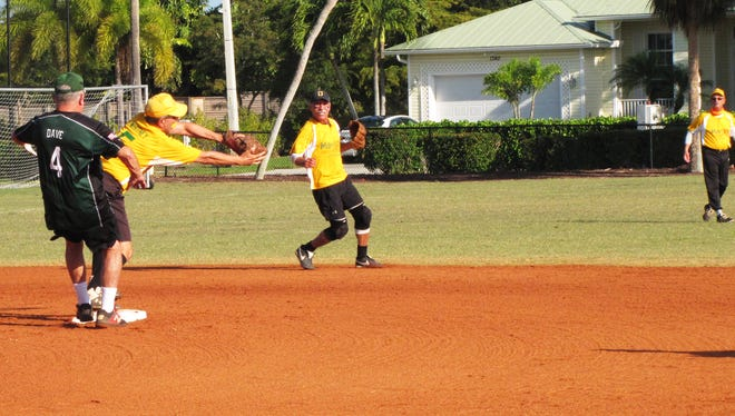 Todd Whitney attempts the force out at second base on Joey D's Dave Coward.