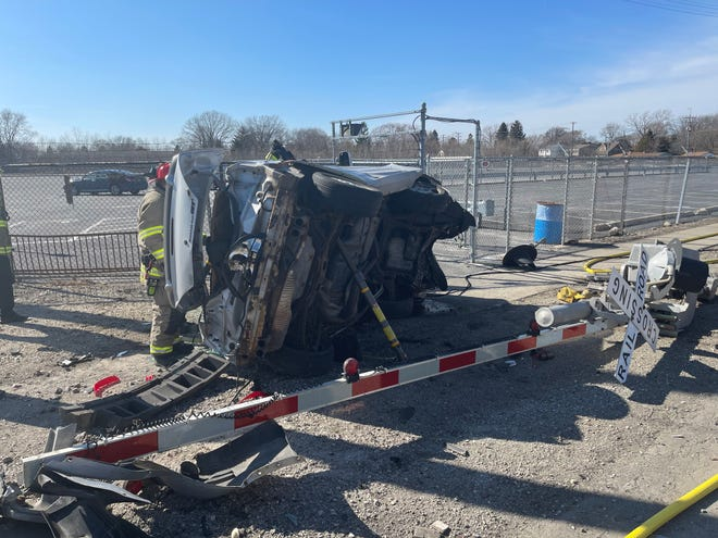 Cudahy and South Milwaukee fire departments rescued a driver trapped in her vehicle after she struck a railroad gate on the west side of South Whitnall Avenue on March 13.