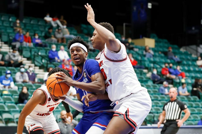 Louisiana Tech's JaColby Pemberton is guarded by Western Kentucky's Isaiah Cozart during the NIT basketball tournament on March 25, 2021.
