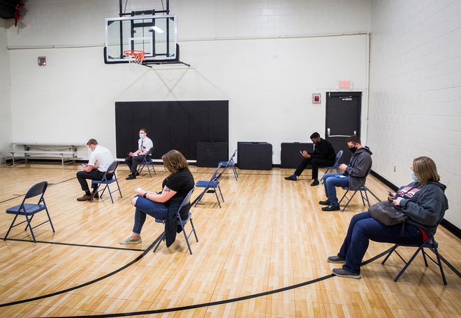 Muncie residents receive the Moderna or Johnson & Johnson COVID-19 vaccine during a one-day partner vaccination site setup at the Buley Center Friday, March 26, 2021. Thirty to 40 people were expected to arrive for vaccinations during the temporary event.