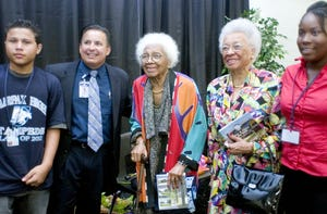 Betty H. Fairfax (center), an 89-year-old counselor at Central High in Phoenix, stands with freshman Casey Manues (left), principal Zachary Munoz, sister Jean Fairfax, and freshman Imani Craig, after a dedication ceremony at the new Betty H. Fairfax High School in Laveen. Fairfax is the first Phoenix Union High School District employee to have a school named on her behalf.