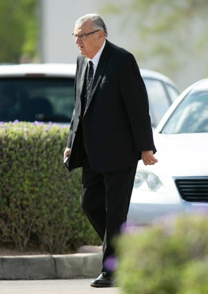 Former Maricopa County Sheriff Joe Arpaio walks into St. Timothy Catholic Church in Mesa for the funeral Mass of his wife Ava Arpaio on March 26, 2021.