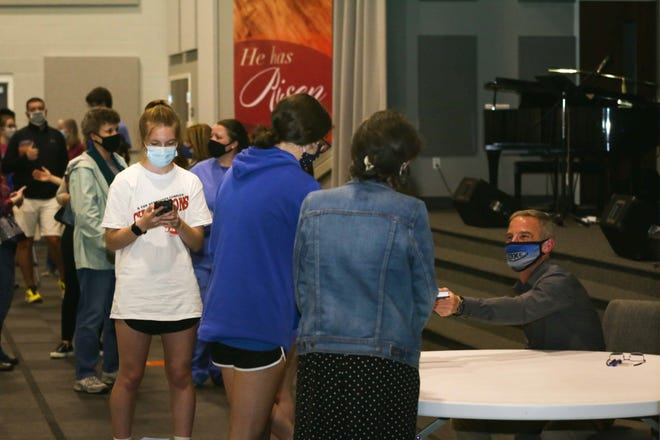 "The line was long at Fairlane Brethren Church in Cleona Thursday night as folks lined up for a signed copy of Cedar Crest track and field coach Rob Bare's new book, ""Braving Your Adversity."""