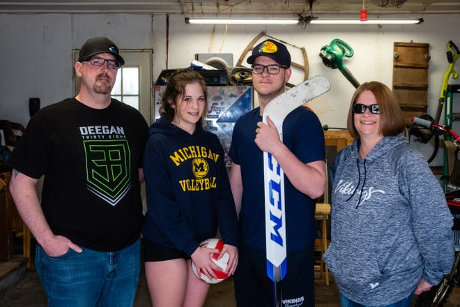 From left, Chad, Lindsey, Tyler and Jami Mckenney pose for a portrait Thursday, March 25, 2021, in their home in Marysville. Lindsey and Tyler both had their sports seasons interrupted by COVID-19.