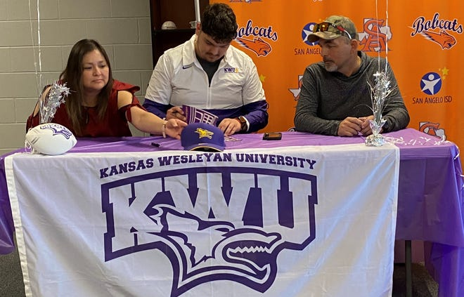 San Angelo Central High School senior offensive lineman Chris Muns makes his college plans official to play for Kansas Wesleyan University next season during a ceremony at the San Angelo Stadium field house on Thursday, March 25, 2021. His parents watched him put pen to paper.