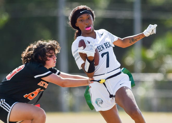 Jensen Beach's Vanessa Queen tries to elude a Lincoln Park Academy defender during a high school flag football game on Friday, March 26, 2021, in Fort Pierce.  Jensen Beach won 20-0.