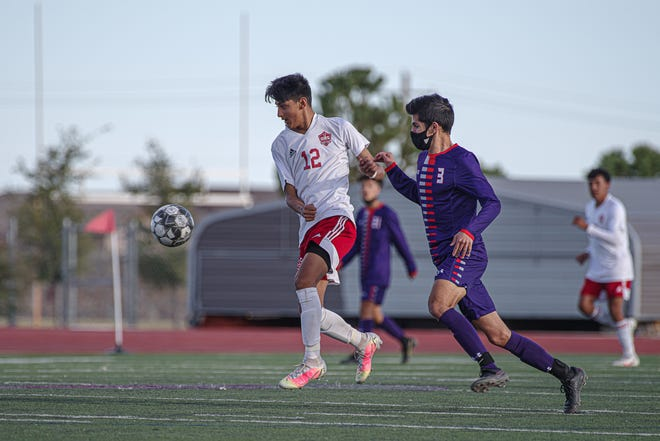 Odessa's Camilo Nicolas and Eastlake's Oscar Yanez chase the ball. Eastlake High School's varsity boys soccer team defeated Odessa 5-0 to win the Class 6A bi-district championship at Eastlake High School on March 25, 2021.