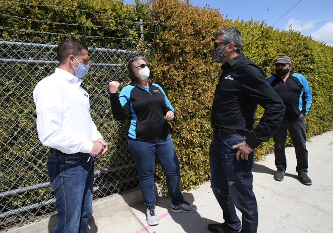 Sergio Burga, from left, Mary Anne Rooney, Zahur Lalji and Mike Barber view potential properties for a marijuana dispensary on Ventura Boulevard in Nyeland Acres, near Oxnard, on March 25.