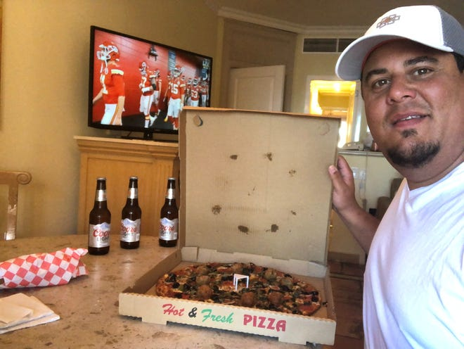 Antonio Delgado ordered in pizza for his Super Bowl party of one in his hotel room in Cabo San Lucas, Mexico. He tested positive for COVID-19 during the trip and had to isolate and delay his return home.