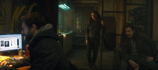 "Karli Morgenthau (Erin Kellyman, center) hides out from the authorities with fellow Flagsmashers Nico (Noah Mills) and Dovich (Desmond Chiam) in ""The Falcon and the Winter Soldier."""