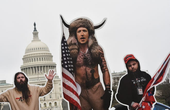 An effigy of Facebook CEO, Mark Zuckerberg (C), dressed as a Jan. 6 insurrectionist is placed near the Capitol in Washington, DC, on March 25.
