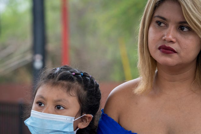 Leonela Julissa Hercules (right), of San Pedro Sula, Honduras, sits with her daughter, Rosa, during an interview at La Posada Providencia shelter in San Benito, Texas, on Tuesday, March 23, 2021.