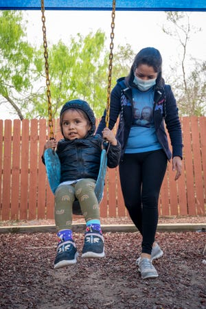 Fausta Vásquez, 30, of Honduras, plays with her daughter Génesis, 2, at La Posada Providencia shelter in San Benito, Texas, on Tuesday, March 23, 2021.