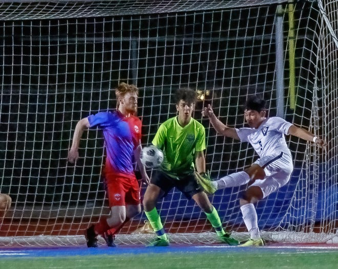Vandegrift's Ethan Dacaret fires off the game-winning goal against Westlake late in the second half at the Class 6A bidistrict boys soccer playoff game Friday at Westlake High School.