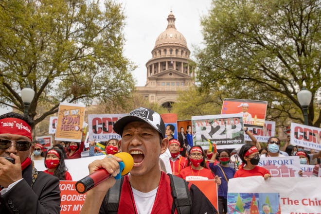 Salai Thomas Hehzai marches at the Capitol on Saturday to raise awareness about the political turmoil in Myanmar. Hundreds reportedly have been killed by the military there during protests against a Feb. 1 coup.