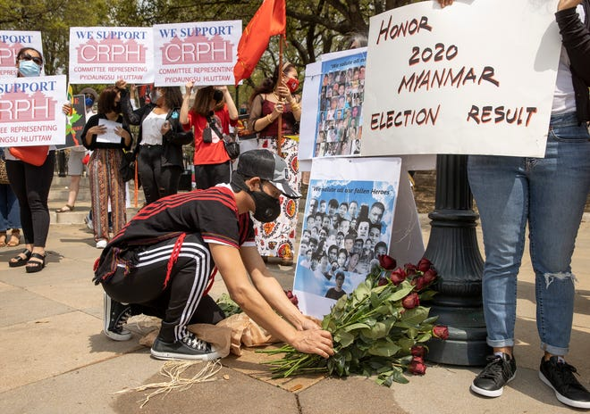 Salai Thomas Hehzai lays roses as a remembrance of those who have been killed in the protests of the coup in Myanmar.