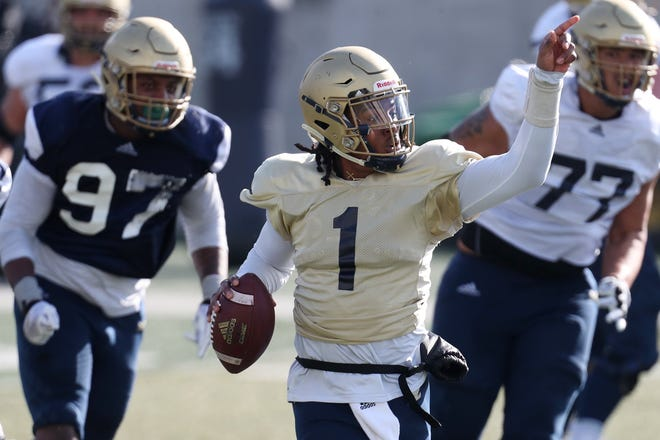 University of Akron quarterback Kato Nelson gestures to a receiver as he gets set to pass on the run during the UA football scrimmage at InfoCision Stadium on Saturday. [Mike Cardew/Akron Beacon Journal]